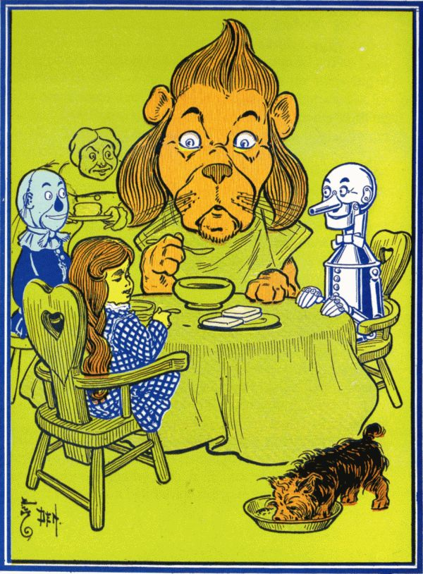 Vintage illustration from original Wonderful Wizard of Oz of Dorothy, scarecrow, tin man and lion sitting around dinner table