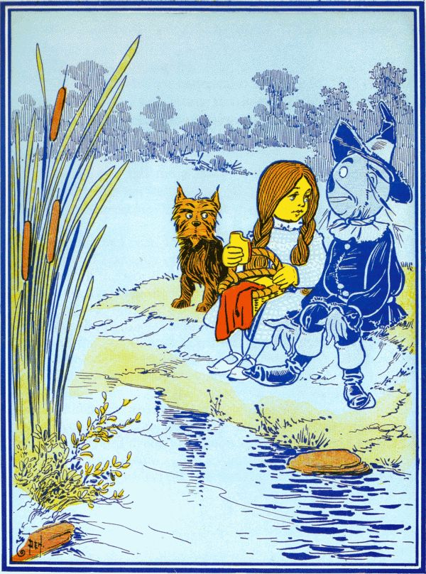 Vintage illustration from original Wonderful Wizard of Oz of Dorothy, scarecrow and Toto by the lake