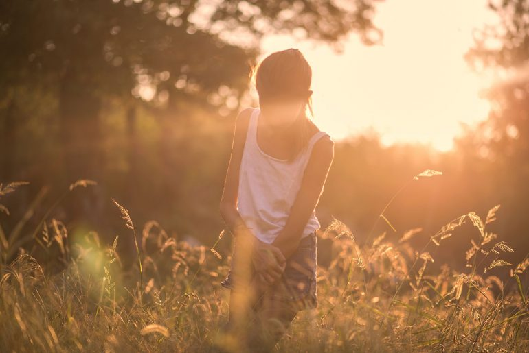 Image of girl at sunset for parenting article Identifying Mental Health Problems in Children